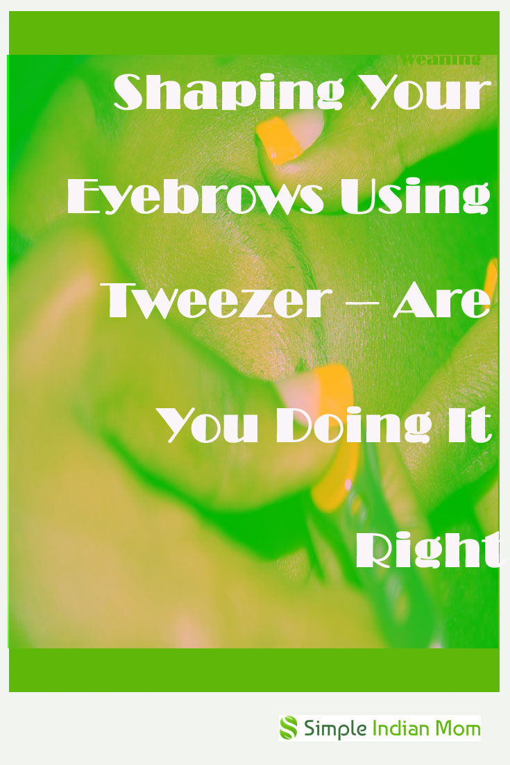 shaping eyebrows using tweezers